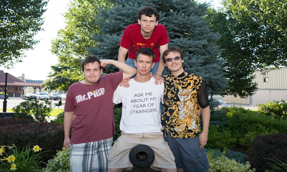7/11/12 5:40:19 PM -- Salem, Massachusetts BU alum Noah Britton (CAS '05) with his cast members of the comedy troupe, Asperger's 'R' Us in Salem, MA.  Cast members include Noah Britton (white shirt), New Michael Ingemi (black/gold shirt), Jack Hanke (red shirt), Ethan Finlan (purple Mr. Pibb shirt) Photo by Jared Charney for Boston University Photography